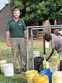 Daniel Oerther posing next to a water stand in Otho Abwao Kenya.jpg