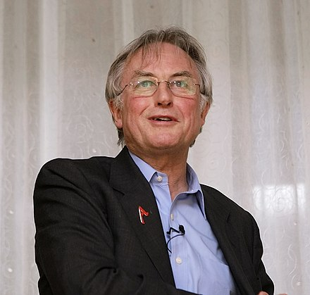 Wearing a scarlet 'A' lapel pin, at the 34th annual conference of American Atheists (2008) Dawkins aaconf.jpg