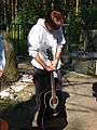Day 3- Banna standing with her guitar after the ceremony (45077606).jpg