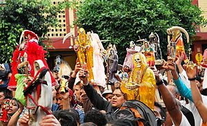 Colonia Morelos - Raising Santa Muerte images during a service for Santa Muerte in Tepito