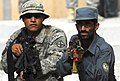 Defense.gov News Photo 100828-N-6538W-076 - U.S. Army Pfc. Alejandro Orona assists Afghan National Police during training at the Afghan police headquarters in Charreh Dera Afghanistan on Aug.jpg