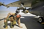 Defense.gov News Photo 120405-F-TM170-057 - U.S. Air Force Maj. Todd Pierce inspects the bombs and missiles on an F-16C Fighting Falcon at Kandahar Airfield Afghanistan on April 5 2012.jpg