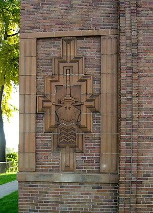 Denby High School - Tile relief decorative element at exterior portal