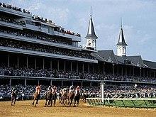 The Kentucky Derby in progress at Churchill Downs.