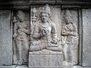 Devata - A male devata, flanked by a two apsaras, Vishnu temple, Prambanan