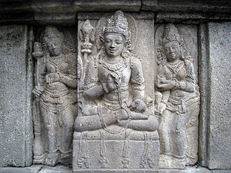 Devata - A male devata, flanked by a two apsaras, Vishnu temple, Prambanan
