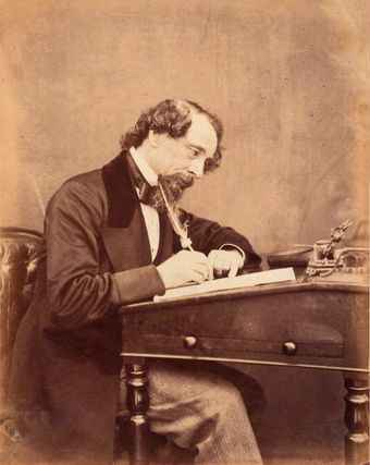 English writer Charles Dickens at his desk in 1858 Dickens by Watkins 1858.png