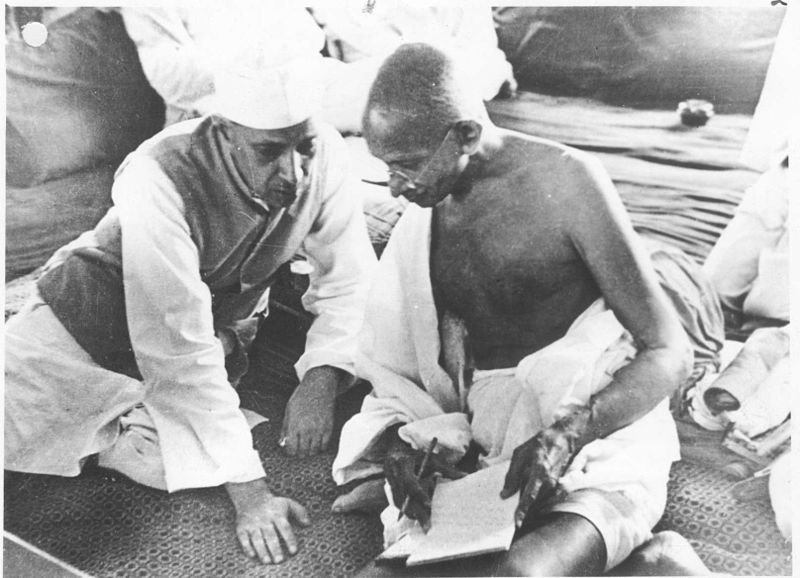 "Gandhi discusses the ""Quit India"" movement with Nehru in 1942.   (Wikimedia Commons)"