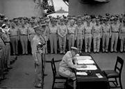 Douglas MacArthur signs formal surrender, NZ rep in back
