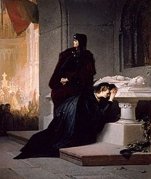Young woman crying at a tomb with her mother standing above her