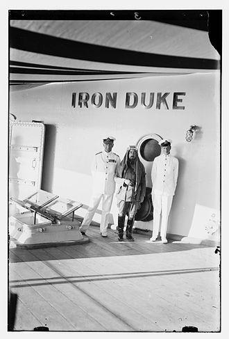 John de Robeck - De Robeck (left) with Emir Abdullah of Jordan (centre) in HMS Iron Duke, flagship of the Mediterranean Fleet, in 1921