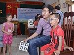 Eye screening for kindergarten children in Quoc Oai district of Hanoi (14124344257).jpg
