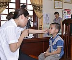 Eye screening for kindergarten children in Quoc Oai district of Hanoi (14310282574).jpg
