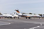 FMG Air (VH-FMG) Bombardier BD-700-1A10 Global Express and JetGo Australia (VH-JGB and VH-JZG) Embraer ERJ-135LR Sydney Airport.jpg