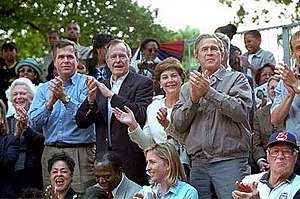 Bush family - Barbara Bush, Jeb Bush, George H. W. Bush, Laura Bush, and George W. Bush, and Hall of Fame pitcher Bob Feller watch tee ball on the White House lawn.
