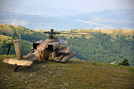 An Israeli Air Force Apache helicopter lands across from a Greek mountain range during a joint Israel-Greece exercise with the Hellenic Air Force. These types of exercises are a central aspect of the Israel-Greece military cooperation.