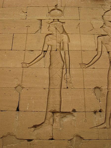 Relief of a woman in Egyptian clothing with an elaborate headdress