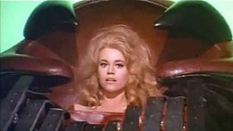 Critics compared Spears' appearance to that of Brigitte Bardot (left) and  Barbarella (right).