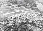 Oblique airphoto of Fort Worth Army Airfield - 1945, looking east to west. The airfield technical area is on the east side of the main north-south runway, with the Consolidated-Vultee aircraft manufacturing facilities (later Convair) on the west side.