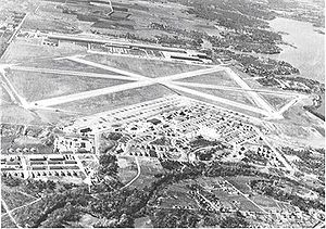 Carswell Air Force Base - Oblique airphoto of Fort Worth Army Air Field in 1945, looking east to west. The airfield technical area is on the east side of the main north-south runway, with the Consolidated-Vultee aircraft manufacturing facilities (later Convair) on the west side.