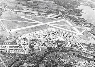 Naval Air Station Joint Reserve Base Fort Worth - Oblique airphoto of Fort Worth Army Air Field in 1945, looking east to west. The airfield technical area is on the east side of the main north-south runway, with the Consolidated-Vultee aircraft manufacturing facilities (later Convair) on the west side.