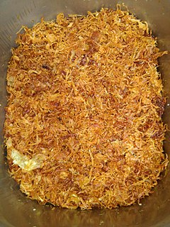 Fried onion snack food or garnish; sliced onions pan-fried or sautéed until soft and somewhat browned