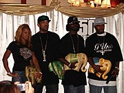 From left: With Olivia, Lloyd Banks, and Young Buck in Bangkok, Thailand, February 2006