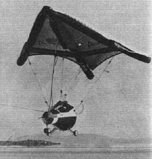 History of hang gliding - United States Gemini's Paresev glider in flight with tow cable.