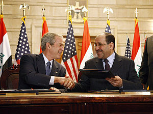 Nouri al-Maliki - U.S. President George W. Bush and al-Maliki shake hands during the press conference.