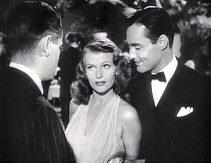 Mark Roberts (actor) - Mark Roberts (to the right of Rita Hayworth) in a trailer for Gilda