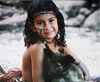 A girl with a dog at Island of Wagifa in Papua...