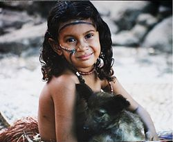 A girl with a dog at Island of Wagifa