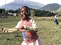 Girl with stick smiling.jpg