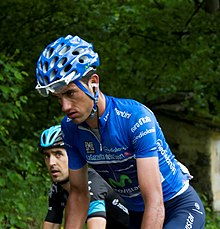 Beñat Intxausti riding uphill in the blue jersey of the leader of the mountains classification