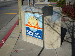 Concrete bollard on San Pablo Avenue marking the Golden Gate Shopping District