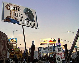 Greed Lies Murder Protest sign.jpg