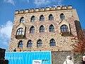 Hambacher Schloss von Süden mit Ausstellungsplakat.jpg