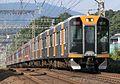 Hanshin 1000 1601F+9000 9203F Kintetsu Nara Line rapid express 2012-10-21 (12083540445).jpg