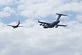 Heritage Flight Boeing C-17A Globemaster III de Havilland CV-2B Caribou 62-4149 1st Pass 17 SNF 16April2010 (14443815658).jpg