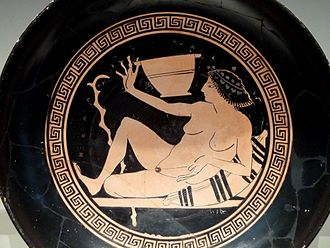 Hetaira - This painting, on the inside of a kylix, depicts a hetaira playing kottabos, a drinking game played at symposia in which the participants flicked the dregs of their wine at a target.