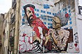 Hipster with a selfie stick punished by old Lady • The Greatest Graffiti in Lisbon, Portugal (49667847112).jpg