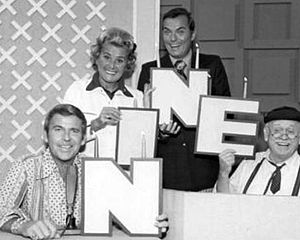 The Hollywood Squares - Celebrating the start of its ninth year on the air in 1974, (L–R) are Paul Lynde, Rose Marie, host Peter Marshall and Cliff Arquette as Charley Weaver.