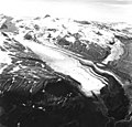 Hook Glacier, terminus of valley glacier partially covered in rocks and other debris, icefall on upper portions of the mountain (GLACIERS 6658).jpg