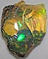 Hydrophane opal (precious opal) immersed in water (Tertiary; Ethiopia) 5 (31868699304).jpg
