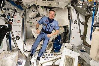 """Locomotion in space - Expedition 43 commander and NASA astronaut Terry Virts shows off a special suit for his preparation process to return to Earth later. Virts tweeted this image with an explanation of the suits purpose on May 12, 2015: """"Our """"Penguin (пингвин)"""" suit- it compresses you, to get your body ready for the return to gravity""""."""