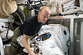 ISS-47 Tim Kopra with space suits in the Quest airlock.jpg