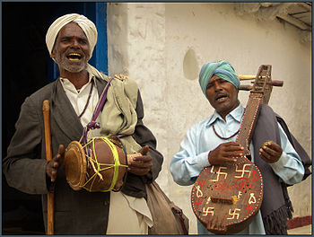 Village musicians in Hyderabad singing and pla...