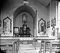 Interior d'una església amb l'altar al fons.jpeg
