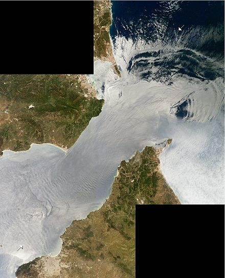 The Strait of Gibraltar with the Mediterranean Sea in upper right. Internal waves (marked with arrows) are caused by water flowing through the Strait (bottom left, top right). InternalWaves Gibraltar ISS009-E-09952 54.jpg