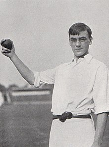 A cricketer holding a cricket ball